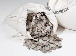 Linen bag of old pure silver coins used to invest in silver as a commodity