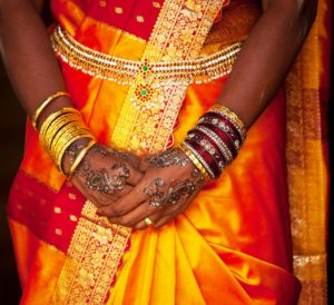 Traditional Indian garb with gold jewelry: MetalsWired Gold Blog