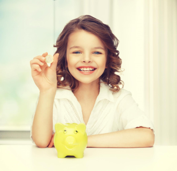 Young girl with piggy bank: MetalsWired Kids' Coin Corner Blog