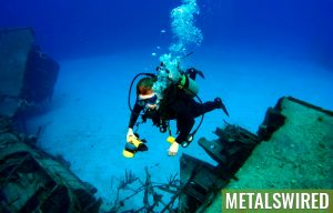 Diver takes photograph at shipwreck site
