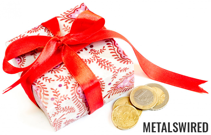 a few collectible coins next to wrapped gift