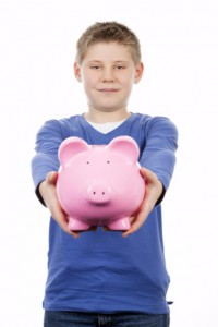boy holding piggybank; Metalswired Kid's Corner article